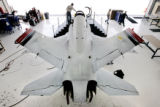 Employees of Aviation Technology Group work on the Javelin jet at Centennial Airport on July 8,...