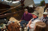 (GRANBY, CO., JUNE 7, 2004)(Center LT. TO RT.) Colorado Congressman Mark Udall, listens to Casey...