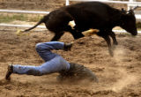 Sean Basinger, of Greeley, Colo., was awarded no score after getting tripped up in the steer...