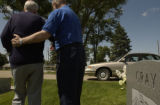(BRUSH, Colo., June 2, 2004) Harold is escorted away from his headstone by Stan. They had been...