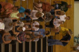 Displaced residence evacuated from their homes because of the Mason Wildfire meet in the gymnasium...