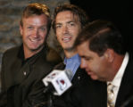 Colorado Avalanche defenseman Rob Blake, left, and forward Joe Sakic laugh while General Manager...