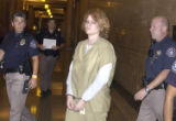 Lisl Auman enters Denver County court on Monday July 11, 2005.  Auman pled guilty to 2nd degree...
