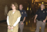Lisl Auman leaves Denver County court on Monday July 11, 2005.  Auman pled guilty to 2nd degree...