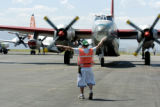 Broomfield, CO July 11, 2005  Lane Phillips directs a slurry bomber away from the tarmac and to...