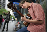 Aaron Briggs, 16, Denver, plays his guitar on the 16th Street Mall on Tuesday, July 26, 2005. ...