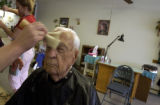 (BRUSH, Colo., April 7, 2004) Harold gets a final brushup at the end of his haircut at J and J's...