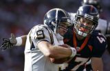 JPM1362-- Denver Broncos safety John Lynch, right, sacks  San Diego Chargers quarterback Drew...