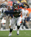 Denver Broncos Mike Anderson is stopped by San Diego Chargers Donnie Edwards on third down in the...