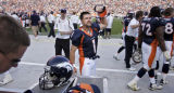 The Denver Broncos' Jason Elam (#1, K) acknowledges the crowd's cheers after kicking a game...
