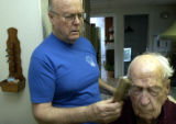 (BRUSH, Colo., April 23, 2004) Stan brushes Harolds eyebrows and hair after his shower and before...