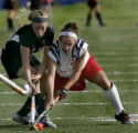 Kent Denver Sun Devils' #24, Lauren Miller, right, battles for the ball with Colorado Academy...