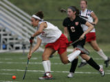 Kent Denver Sun Devils' #24, Lauren Miller, left, cuts up field past Colorado Academy Mustang's...