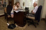 (BRUSH, Colo., June 9, 2004) Carrie Gray reads to her granddad, Harold. She takes over a couple...