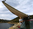 Dan Jaffe (cq), from Boulder, secures his kayak to the roof of his car after a day out on Gross...