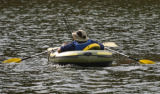 A fisherman in a inflatable raft makes his way back to shore after a day of fishing at Gross...