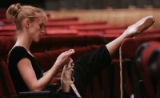 JPM009  Janelle Cooke (cq) a senior soloist at the Colorado Ballet repairs her shoes as the...