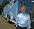 Douglas Oberhamer (cq), President of Deep Rock Water Company,  by one of their new trucks Monday...