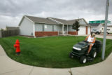 Frank Wozney, cq, an eight year resident of the Gateway subdivision in Greeley, mows his lawn on...