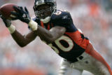 Rod Smith hauls in a pass on the one yard line in the second half of the Denver Broncos against...