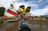Jay Price, shore director at Standley Lake carries Eduardo Amaya to a sailboat boat Wednesday...