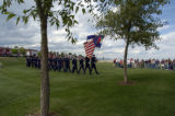 The West Metro Fire Rescue Honor Guard leads firemen from eight metro area fire departments during...