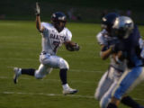 Dakota Ridge running back, Cody Lunsford, left #7, runs for a first down in the second quarter of...