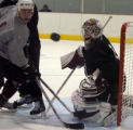 Goalie Peter Budaj and Cody McCormick watch the puck in a game on the last day of Colorado...