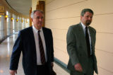 (DENVER  Colo., July 19, 2004)   Naturopath Brian O'Connell, right, walks with his lawyer Craig...