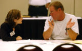by Jan-Michael Stump -- Bret Buckel (cq) of Meraux, LA, talks with Suzanne Forrest, staffing...