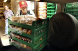 L to R: George Drotar (cq) at the food bank of the Immaculate Heart of Mary Church on Wednesday...