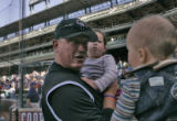 Colorado Rockies Manager, Clint Hurdle, left, makes a face at his ten-month-old son Christian...