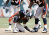 Champ Bailey sits on the ground after being injured in the third quarter of the Denver Broncos...