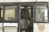 (LT. TO RT.) Colorado National Guardsman Zachary Reynolds (CQ), of Littleton, searches a bus for...