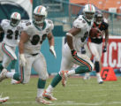 Jason Taylor runs back for a touchdown on a fumble recovery on the final play of the game of the...