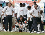 Jake Plummer sits on the sidelines after throwing his second interception of the game in the...