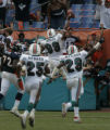 JPM369  Miami Dolphins Jason Taylor leaps into the end zone for a touchdown after recovering a...