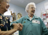 Edna Cary (cq) (right)  is congratulated by Grace Chewning (cq)  at the Second Hand Shoppe Monday...
