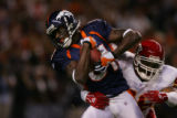 Denver Broncos wide receiver Charlie Adams is tackled by Kansas City Chiefs linebacker Derrick...
