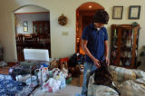 Amy E. Voigt      September 8, 2005  Surrounded by evacuation supplies, John Thompson (cq), 16,...
