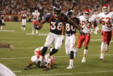 Denver Broncos' running back Mike Anderson (38) runs in for a touchdown in front of Kansas City's...