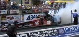 (Morrison, Colorado. July18, 2004) Scott Kalitta burns out before his winning run in the finals ...