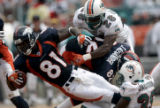 JPM723 Photo shows Broncos #81-Charlie Adams being brought down by Miami Dolphins #35-Jackson at...
