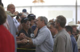 Louisiana locals and volunteers greeted President George W. Bush, at the Emergency Operation...