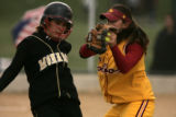 Monarch's Melanie Pinto (cq), left, tries to avoid being tagged out by Rocky Mountain's Corinna...
