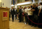 President Aleksander  Kwasniewski of Poland walks to a podium  during a reception at the Newman...