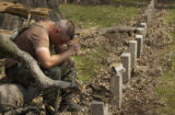 Colorado National Guardsman PV2 Bryan Lyon (CQ), of Arvada, takes a few minutes to rest on a...