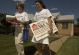 (DENVER, Colo., July 12, 2004) Beth McCann comes away from a home in the neighborhood with Jenny...
