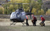 Search and Rescue workers are are loaded into one of three helicopters staging from Freedom Park...