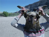 An animal bone makes an impromtu mask for a young camper in the Green River/Desolation Canyon...